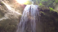 Underneath a waterfall Stock Footage