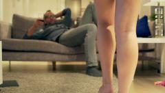 Woman surprising man on the sofa by taking off towel Stock Footage
