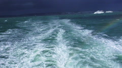 View on the North sea on a rainy day with a rainbow Stock Footage