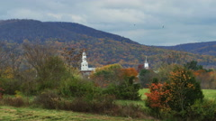 2410 Church with Mountian Behind with Birds Circling During Fall, 4K Stock Footage
