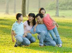 Asian family enjoying outdoor at the park Kuvituskuvat