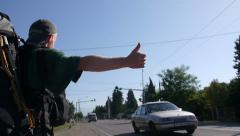Hitchhiking backpacker Stock Footage