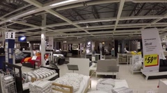 One side of people shopping their furniture inside ikea Stock Footage