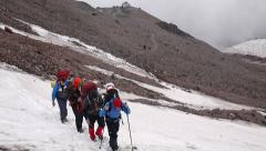 Group of Alpine Climbers ascending through snow in Mountains Stock Footage