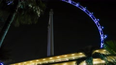 4k UHD time lapse video of Singapore Flyer with color changing lightings Stock Footage