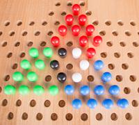 Chinese checkers wooden board game Stock Photos