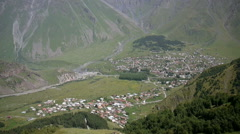 Looking down at kazbegi village from above Stock Footage