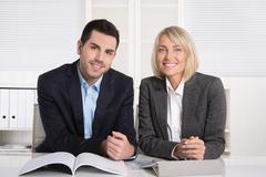 successful team work: businessman and older female managing director in portr - stock photo