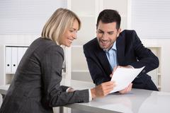 Successful business team or costumer and client in a meeting. Stock Photos