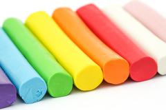 Colorful rod plasticine arranging on white background Stock Photos