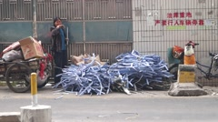 A collecting scrap of women, in Shenzhen, China Stock Footage