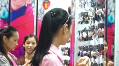 Young women in the purchase of hairpin - stock footage