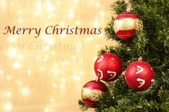 Closeup of xmas-tree decorations and merry Christmass sign - stock photo