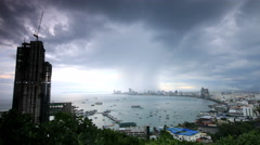 Storm clouds and rain over Pattaya city Thailand, time lapse 4k 4096x2304. Stock Footage