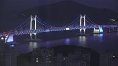 Aerial of Gwangan Suspension Bridge At Night Colored Lights 4K Stock Footage