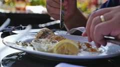 Man eating fish and chips, slow motion Stock Footage
