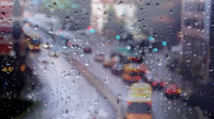 Rain Bokeh lights  glass Rainy day winter is coming Stock Footage