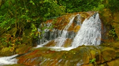 phuket, thailand. waterfall on a creek in the rainforest - stock footage