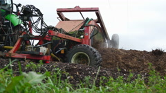 Industrial tractor shoveling Cow Feces to create fertilizer Stock Footage