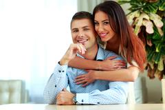 young smiling couple hugging at home - stock photo