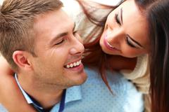 Closeup portrait of a smiling couple Stock Photos