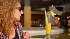 Young Woman Waiting for Her Boyfriend with Fruit Shake in Cafe. Stock Footage