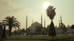 Blue Mosque silhouette Istanbul sunset pedestrians walking on pavement sidewalk, Stock Footage