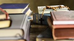 Bible in the bookshelf,zom in Stock Footage