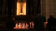 Cathedral. Votive candles burning opposite the Crucifix Stock Footage