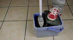 Mopping The Floor 50p - Dolly shot Stock Footage