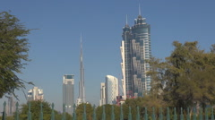 Beautiful view Burj Khalifa modern building Dubai city tree leaf sunny day icon Stock Footage