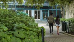 Young Couple Entering Natural Science Museum in Houston TX Stock Footage