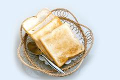 toat slide whole weet bread on rattan basket - stock photo