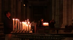 Faithful lighting candles in the Church - stock footage