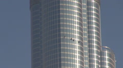 Closeup climber man wash glasses facade Burj Khalifa tower building Dubai city  Stock Footage