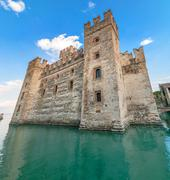 rocca scaligera is a castle in sirmione on lake garda. the castle is surround - stock photo