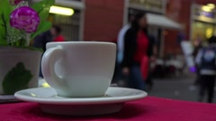 Italy, Rome, cup on table of street cafe near fountain Trevi. Stock Footage