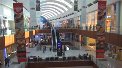 Beautiful interior shopping mall hall Dubai city famous brand shop people relax  Stock Footage