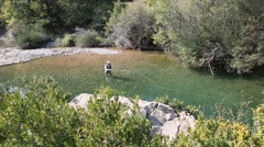 Upper view of fly fisherman in river Stock Footage