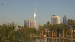 Panoramic view Burj Khalifa modern building tower water lake Dubai exotic park  Stock Footage