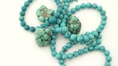 Turquoise gems gemstone necklace turning slowly Stock Footage