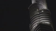 Burj Khalifa tower silhouette night illuminated skyscraper Dubai center dark Stock Footage
