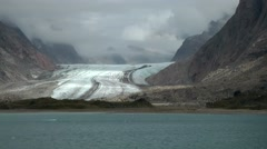 Greenland Prince Christian Sound 022 melting glacier in a valley Stock Footage
