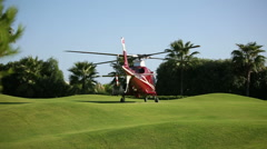 A helicopter prepares for takeoff. Sequence 2 shot Stock Footage