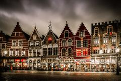 decorated and illuminated market square in bruges, belgium - stock photo