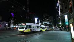 Dallas Dart Commuter train leaves downtown station at night Stock Footage