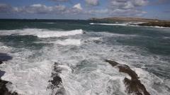 Cornish sea and waves lapping over rocks Treyarnon Bay Cornwall England UK Stock Footage