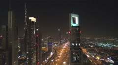 Panoramic view Burj Khalifa busy Sheikh Zayed Road night Dubai city downtown sky Stock Footage