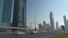 Traffic street Sheikh Zayed Road freeway Dubai business area skyscraper building Stock Footage
