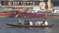 Pan left fallow tourist people enjoy travel abra traditional boat Dubai Creek  Stock Footage